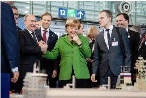Putin con Angela Merkel